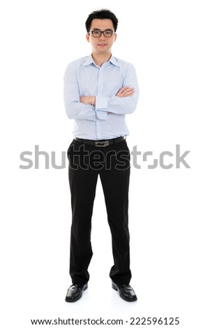 Full length Asian businessman arms crossed standing isolated on white background. - stock photo