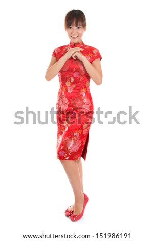 Full length Asian woman with Chinese traditional dress cheongsam or qipao respecting on Chinese New Year Festival. Female model isolated on white background. - stock photo