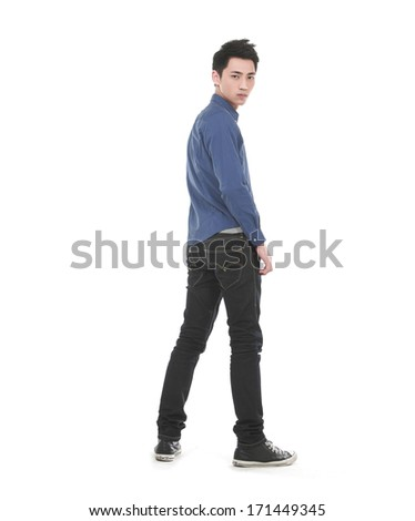 Full length Attractive Asian young man back  - stock photo