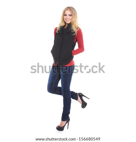Full-length attractive young woman posing in studio - stock photo