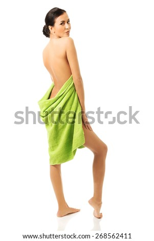 Full length back view woman wrapped in towel. - stock photo