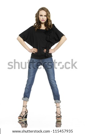 Full length beautiful fashion woman in jeans with bag posing - stock photo
