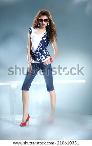 Full length Beautiful hairstyle girl on light background/ Studio shot  - stock photo