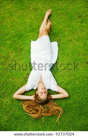 Full-length beautiful woman on the grass - stock photo