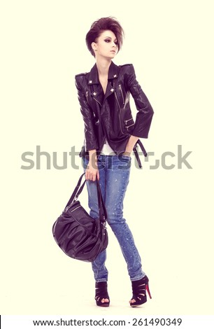 Full length beautiful young woman in jeans with handbag - stock photo