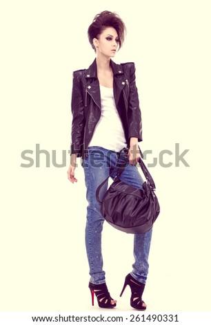 Full length beautiful young woman with handbag posing  - stock photo