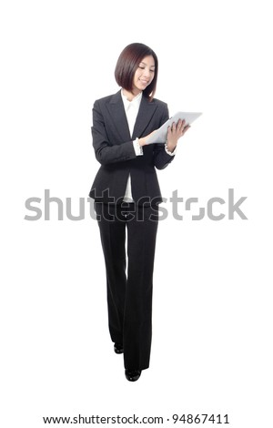full length business woman smiling using touch pad tablet pc isolated on white background, model is a asian beauty - stock photo