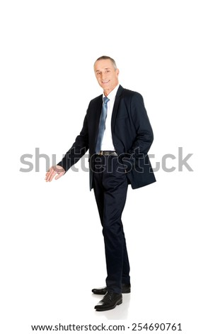 Full length businessman leaning on empty blank on the floor. - stock photo
