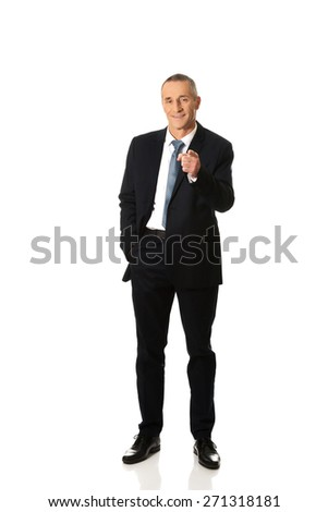 Full length businessman pointing on you. - stock photo
