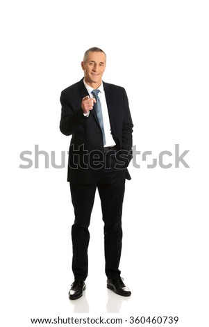 Full length businessman pointing on you - stock photo