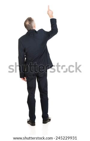 Full length businessman pointing upwards. - stock photo