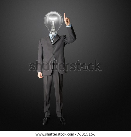full length businessman with lamp-head push the button on virtual touch pad - stock photo