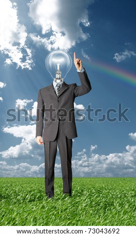 full length businessman with lamp-head push the button on virtual touch pad outdoors - stock photo
