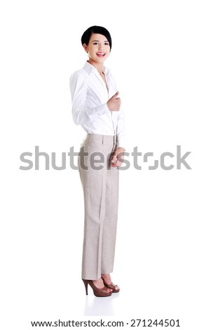 Full length businesswoman gesturing thumbs up. - stock photo