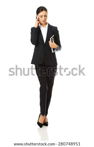 Full length businesswoman holding her notes. - stock photo