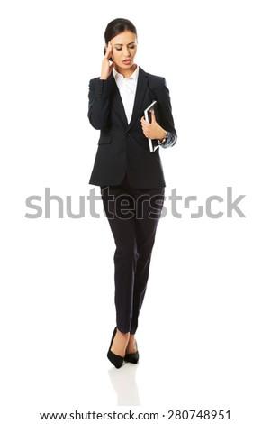 Full length businesswoman holding her notes. - stock photo
