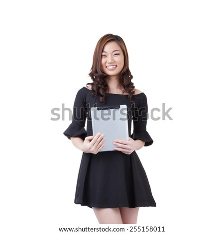 Full length businesswoman using digital tablet computer PC happy isolated on white background. Beautiful mixed race Asian with finger on touch screen display. - stock photo