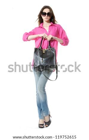 Full length casual fashion women wearing red shirt holding bag posing shot in studio - stock photo