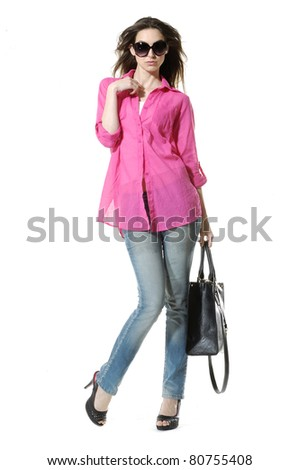 Full length casual picture of young woman in blue jeans holding bag - stock photo