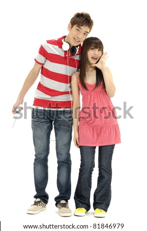 Full length casual young couple with headphones having fun - stock photo