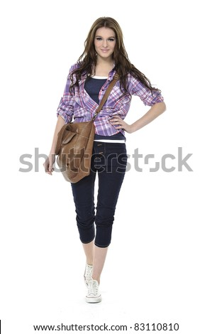 full-length casual young fashion walking in Isolated Studio - stock photo