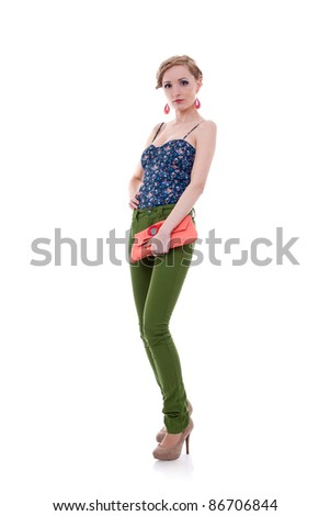 Full length casual young fashion woman holding bag posing - stock photo