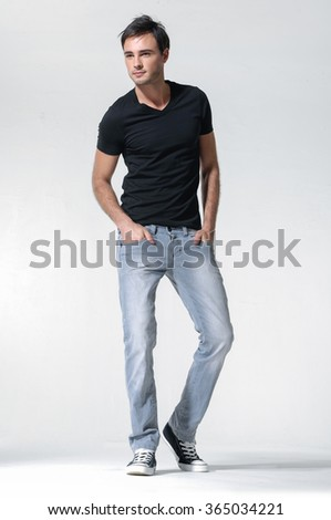 Full length Casual young man in jeans standing - isolated over a white background