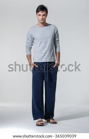 Full length Casual young man standing - isolated over a white background - stock photo