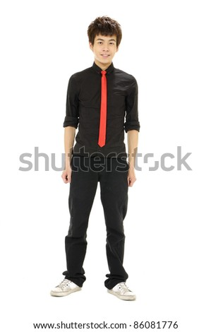 Full length casual young man standing on white background - stock photo