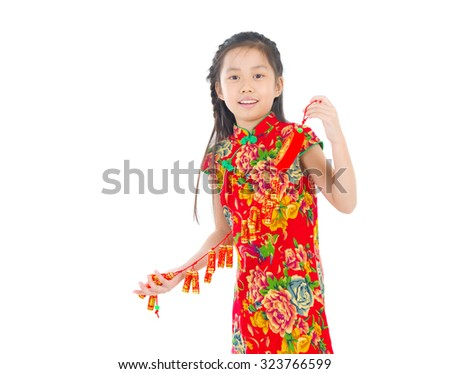 Full length China girl in traditional Chinese dress greeting, holding a gold ingot standing isolated on white background