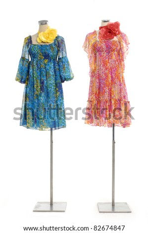 full-length dress on two mannequin isolated - stock photo