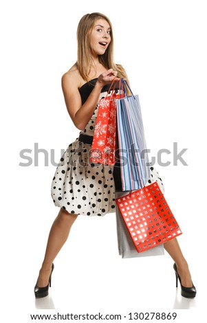 Full length expressive female with shopping bags, over white background