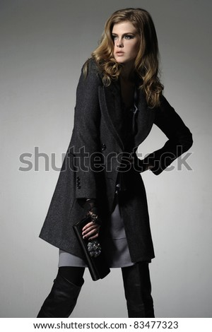 Full length fashion girl posing in the studio - stock photo