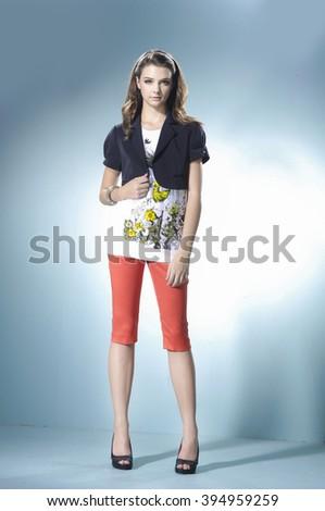 Full length fashion or casual girl posing on light background/ Studio shot - stock photo