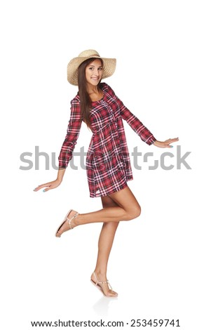 Full length fashion portrait of happy playful woman in country style isolated on white  backgorund.  Smiling woman wearing chequered summer dress and broad-brim straw hat - stock photo