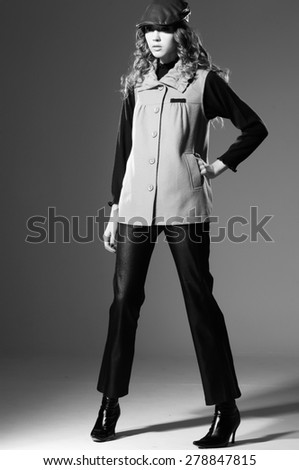 full-length fashion shot of girl in hat posing in black and white