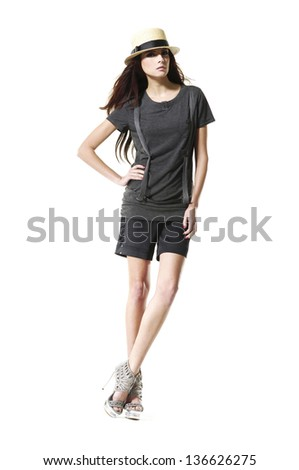 full-length fashion shot of girl with sunglasses posing   - stock photo