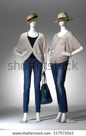 full-length female clothes in jeans with bag on a two mannequin - stock photo