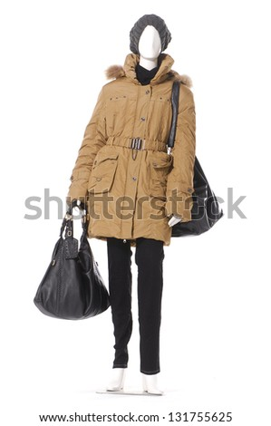 full length female clothing in hat with winter coat with bag on mannequin - stock photo