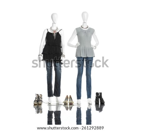 full-length female clothing with jeans ,boots on two mannequin  - stock photo