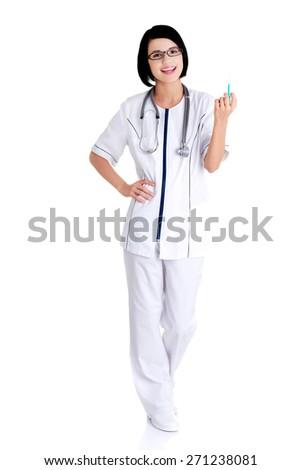 Full length female doctor holding syringe. - stock photo