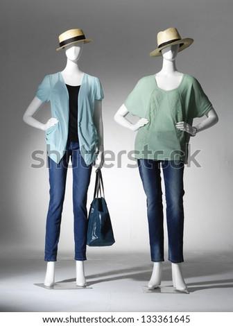 full-length female dress in jeans with handbag on mannequin - stock photo