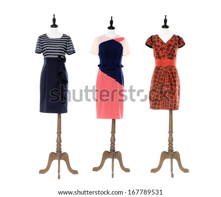 full-length female dress on three dummy isolated   - stock photo