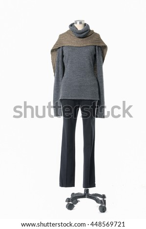 full-length female dress with scarf and trousers isolated on a dummy    - stock photo