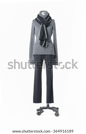 full-length female dress with scarf and trousers on n mannequin-white background    - stock photo