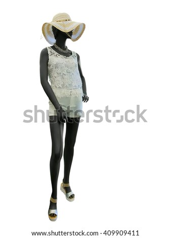 Full-length female mannequin clothing in straw hat, blouse with embroidery and shorts, isolated on white background. No brand names or copyright objects. - stock photo