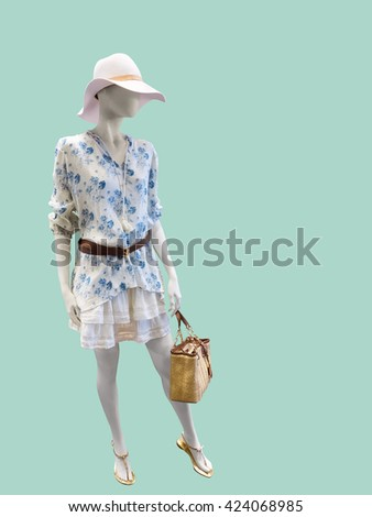 Full length female mannequin dressed in fashionable clothes, Isolated on green background. No brand names or copyright objects. - stock photo