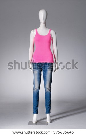 full-length female mannequin in red t-shirt dressed with jeans - stock photo