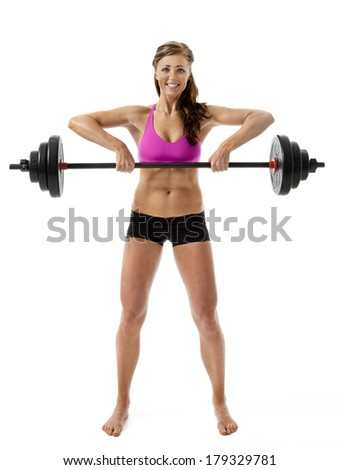 Full length front view of attractive young woman lifting barbell on white background. - stock photo