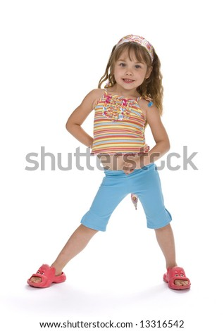 Full length, front view of 5 year old girl standing on white background wearing colorful clothes. - stock photo